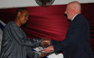 Ken Wright receives his award as Consultant of the Year in Sierra Leone